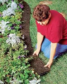 Recycled Rubber Edge Border. Even If You Could Lay Bark Mulch In Perfect Circles Or Borders, It Would Soon Look Ragged Or Need Replenshing. These Mulch Mats Always Look Crisp, Because They Can't Be Scattered. Use Around Raised Beds, Walkways Or Foundation Plantings Mow Right Over It! This is brilliant!