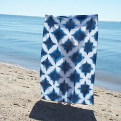 This linen blanket is perfect for the beach, as a table cloth, throw or anything else you can think of. The blankets pattern is created with the Shibori Itajime technique of folding and clamping the fabric then hand-dyeing it in indigo to create this diamond design.~ 100% organic linen~ measures approximately 58 x 84 inches~ topstitched hem~ proudly made by hand in Brooklyn, NY, USACare Instructions:~machine wash cold, tumble dry low heat or hang dryEach blanket ...