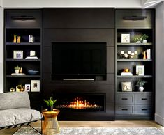 Custom living room wall unit with recessed TV and linear gas fireplace. Includes wall sconces, open shelving and closed drawers. Designed By Myers + Philippe Interior Design. Living Room Wall Units, Dark Living Rooms, Ikea Living Room, Living Room Shelves, Fireplace Tv Wall, Modern Fireplace, Living Room With Fireplace, Custom Fireplace, Linear Fireplace