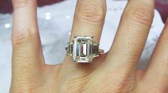 Emerald cut three stone by David Klass Jewelry.