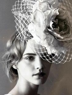 Holy crap that is a huge fascinator! and Emma Watson behind it!