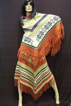 poncho poncho .... Interesting, but, with a pair of boots, a pair of larger than small copper earrings, something to richen it up, it could work ! and looks comfortable !