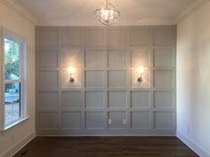 Grey feature wall with wall sconces Grey Feature Wall, Kitchen Feature Wall, Wall Molding, Moulding, Accent Wall Bedroom, Master Bedroom, Wood Panel Walls, Up House, Living Room Grey