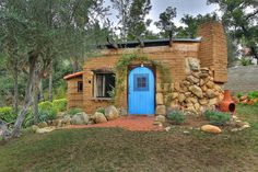 | Small Adobe Brick House |  An earthship home in Brighton, UK  ~ click on photo for inside photo ~