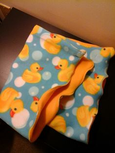 A-Doodles Ducky Blanket...doubled-sided fleece stroller/lap/security blanket is just the right size. Measuring 22 x 28 inches, Ducky and the Bubbles blue, white and yellow, is warm and snuggly, ready to play many roles. See this and other kid blankets, burps cloths and face cloths (coming soon) in the store of Always LOYSE