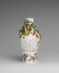 "Vase with coiling dragon 1725  Vienna Porcelain of Du Paquier, 1718-44: The artists at Du Paquier were inspired by a wide variety of sources. It is clear from many formal and decorative parallels that the manufactory had access to both Chinese & Japanese porcelain. Du Paquier, however, seldom copied Asian models directly, preferring instead to adapt & ""improve"" forms and decoration to suit European taste. Here, the Du Paquier artist was inspired by a Chinese porcelain dragon encircling the…"