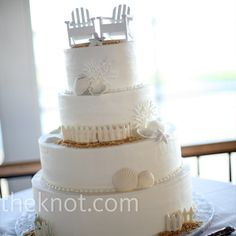 Beach Wedding Cake - two miniature Adirondack chairs topped the butter cream cake, decorated in edible seashells, starfish, and brown sugar sand.