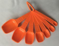 Vintage Tupperware Orange Measuring Spoon Set 8 Piece Ring Handle Complete #Tupperware #MeasuringSpoons