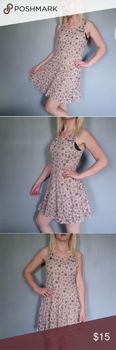 Floral lace dress This adorable dress features printed stretchy floral lace overlaying a nude slip/lining.  Made in USA. Self: 96% nylon, 4% spandex, lining is 100% polyester. In good used condition, no loose elastic or tears in the lace. Deb Dresses