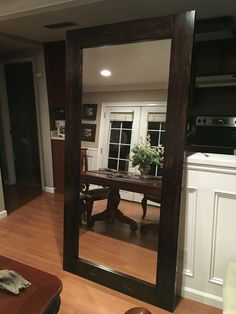 DIY large standing floor mirror from scrap wood and old closet mirror door...cost about $40