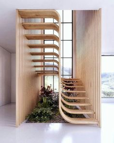 Two flights of stairs flow seamlessly into one another in this sleek sculptural staircase designed by Mexican architecture studio Arquitectura en Movimiento. Curved Staircase, Staircase Design, House Staircase, Stair Design, Staircase Ideas, Interior Stairs Design, Design Bedroom, Wood House Design, Bedroom Ideas
