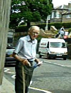 Sir+John+Crofton+about+to+cross+busy+Bridge+Road+in+Edinburgh's+Colinton+district.(Freeze+frame+from+accompanying+video)