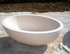 Elegant modern high-end luxurious free standing bathtub made from hand carved stone