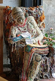 "This mixed media - primarily fabric decorated with bead embroidery - sits in the window of a second-hand shop in Rye, England. The photographer - Gareth Williams - writes that this piece of art reminded him of Miss Havisham from Dickens' ""Great Expectations"". Image courtesy of Gareth's Flickr page at https://www.flickr.com/photos/gareth1953/4328463830/"