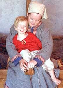 Tunic and trousers were probably typical for boys, and a dress for girls.    Fljótsdæla saga (chapter 11) describes the everyday clothing worn by Helgi and Grímr, boys twelve and ten years old. Their tunics were plain striped rough homespun wool, with trousers below. They both wore cloaks over their tunics.