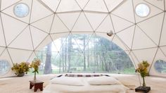 If you're looking for a bit of architectural style with your vacation, forego the traditional cabin or seaside cottage and try staying in a geodesic dome. You'll get off-the-grid lifestyle, secluded locations, and plenty of funky styling.