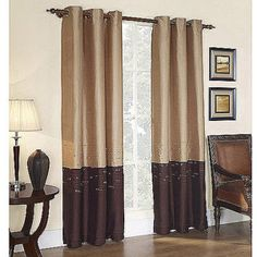 Horizon Grommet Lined Curtain Panel gold and chocolate colored with an aged nickel finish curtain rod in the living room against a blue/purple wall?