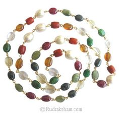 Navratna is the exclusive arrangement of gems. Combination of Ruby (Sun), Pearl (Moon), Coral (Mars), Emerald (Mercury), Golden Topaz (Jupiter), Sphatik (Venus), Blue Sapphire (Saturn), Gomed/Hessonite (Rahu), & Cat's Eye (Ketu)