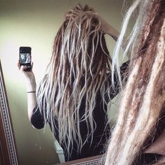 Just finished re-extending and coloring my hair. Dreads are about a foot shorter and all human hair. Waves to match the natural texture, and as close as I could get to my natural color without completely damaging the integrity of the locs. #ombre #dreadlocks