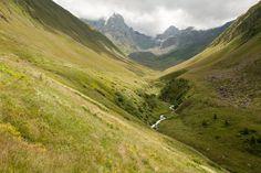 Walking higher into the valley. Juta, Sno valley. Caucasus Georgia