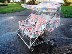 Vintage late-70s double baby stroller with window wind protector.