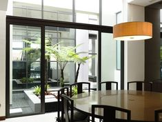 Slatted facade house with sleek adjoined apartment dining area - http://homeides.com/slatted-facade-house-with-sleek-adjoined-apartment-dining-area/