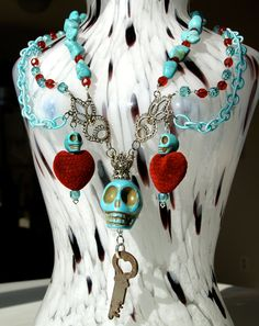 Red and Turqouise Dia de los Muertos Skull and Key Necklace. $140.00, via Etsy.
