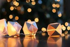 Dress up indoor string lights with basic origami cubes.