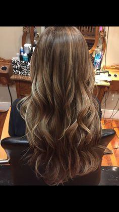 Brown hair with Carmel highlights: