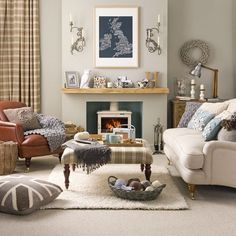 Warm beige walls and an oatmeal carpet create a versatile backdrop for varied texture such as sheepskin, chunky knits, felts and fine weaves. Quirky wall art, sconces and ornaments give the look a quintessentially British, nostalgic feel. - Collection of Country Living Room Styles ~ Home Interior Design
