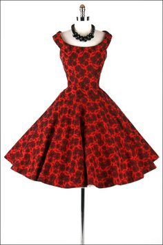 vintage 1950's dress. Love love love the red and black. Also happens to be a very complimentary cut for my shape.