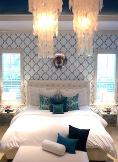 this room is beautiful! love the stenciling, white with pops of color. very pretty