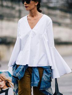 A blusa flare – ou a blusa boca de sino – é uma das principais tendências para o outono/inverno desse ano!