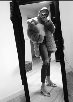 Grey long faux fur coat, white blouse, ripped jeans and silver heels