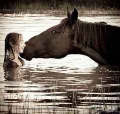 Horse and girl playing around in the river. Awesome photo,