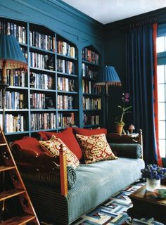 Peacock blue library with daybed