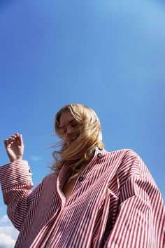 Walk of shame red striped button up and blue sky