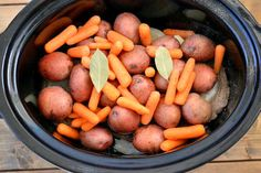Making a London Broil with potatoes and carrots in a crock pot More