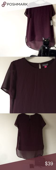 Vince Camuto Hi-Low Top Details: NWT. Purple Vince Camuto short-sleeve Top in a hi-low style in which the back falls several inches longer than the front. Sheer top layer with similarly colored sleeveless undershirt attached.  Retail $79.   Kate Harrington Boutique does not trade or negotiate price in the comment section. However, for most items we may consider reasonable offers.   Happy Poshing! Vince Camuto Tops