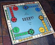 """Sorry! is a board game that is based on the ancient Cross and Circle game Pachisi. Players try to travel around the board with their pieces faster than any other player. Distributed by Parker Brothers, Sorry! is marketed for two to four players, ages six through adult. The game title comes from the many ways in which a player can negate the progress of another, while issuing an apologetic """"Sorry!"""""""