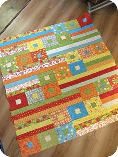 "Super cute and easy jelly roll quilt with square in a square blocks. Since the finished blocks are 6 x 6, I'd say this is 48"" x 54"". Very similar to a quilt from the blog Cluck Cluck Sew."