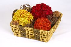 A wicker basket and OASIS Floral Foam Spheres in autumn colors combine to make an arrangement perfect for fall gatherings.