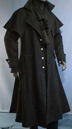 manteau de cocher en coton bourru  fendu au derrière  bouttonné au devant avec des boutons ornés  pèlerine sur les épaules   ce modèle taille très petit, merci de le commande au minimum une...