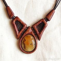 Handcarved wooden necklace with lemon natural---by AnetaMajzner---the designs with the wood make this the most unique line of amber jewelry I have ever seen.