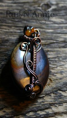 Tiger iron, copper and small carnelian beads.