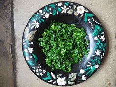 Use garlic oil to create super simple and delicious shredded greens.