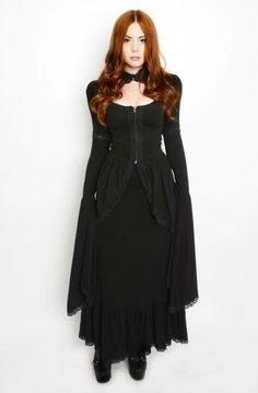 This Stunning dress is inspired by late Victorian fashion. Dress is fully lined and professionally finished with serged seams. It has puff sleeves and a skirt, soft thick patterend stretch fabric, decorated with lots of lace and trim. It closes with clips at the front along with zipper and has wide flaring sleeves and peplum. Beyond gorgeous and comfortable!
