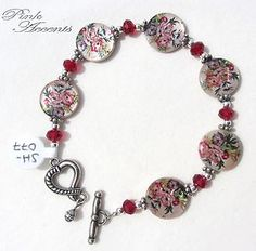 Flower-Printed Shell, Red Glass, and Sterling Silver Plated Bracelet, 7.75 inches.  Check out these natural shell discs featuring pink and purple flowers, elegantly paired with red glass rondelles.  Such a sweet addition to your favorite spring or summer outfit!  Available now in the Pink Accents eBay boutique!