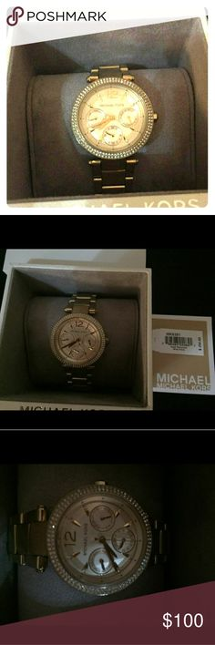 Michael Kors watch with diamond bezel This watch is like new I have had it for about 6 months. There are light minimal scratches on the banned from normal wear but nothing significant there is no color change no deep scratches and no scratches on the face whatsoever and every stone is still in place. I paid $250 for this was 6 months ago I'm letting you have it today for only $100 don't miss this one for sure Michael Kors Jewelry