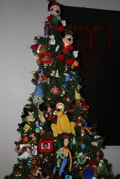 NANA TREE! This is a tree I decorate with toys for my grandchildren.  They are allowed to undecorate it and play with the toys each time they visit.